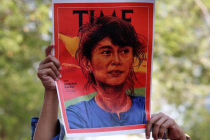 A person holds up a placard depicting Aung San Suu Kyi after the military seized power in a coup in Myanmar, outside United Nations venue in Bangkok, Thailand, 3 February 2021. (Soe Zeya Tun/REUTERS)