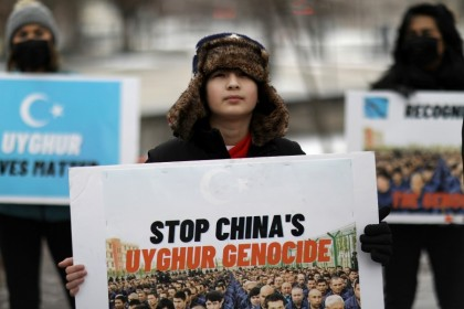 People take part in a rally to encourage Canada and other countries as they consider labeling China's treatment of its Uighur population and Muslim minorities as genocide, outside the Canadian Embassy in Washington, DC, US, 19 February 2021. (Leah Millis/Reuters)