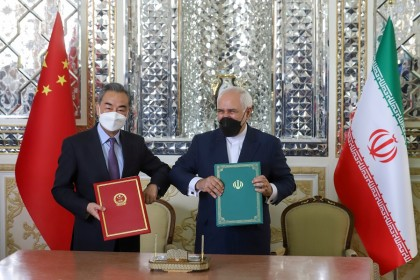 Iran's Foreign Minister Mohammad Javad Zarif and China's Foreign Minister Wang Yi bump elbows during the signing ceremony of a 25-year cooperation agreement, in Tehran, Iran, 27 March 2021. (Majid Asgaripour/West Asia News Agency via Reuters)