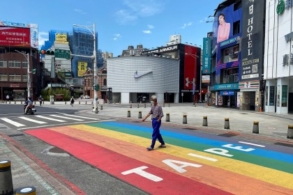 A man crossing the road at Ximending shopping area in Taipei's Wanhua district, Taiwan on 28 May 2021. (Ben Blanchard/Reuters)