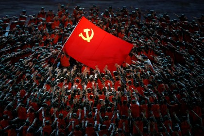 Performers rally around the party's flag during a show commemorating the 100th anniversary of the founding of the Communist Party of China at the National Stadium in Beijing, China, 28 June 2021. (Thomas Peter/Reuters)