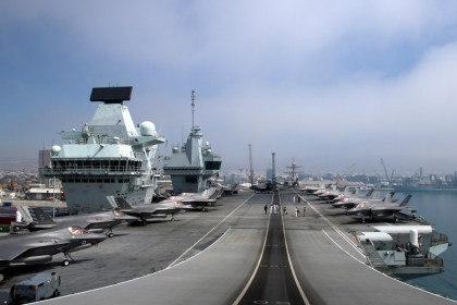 F-35B Lightning II aircraft are seen on the deck of HMS Queen Elizabeth, currently moored at the port of Limassol, Cyprus, 1 July 2021. (Yiannis Kourtoglou/Reuters)