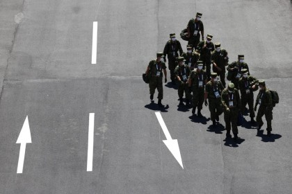 Members of the Japanese Armed Forces walk past the Ariake Urban Sports Park in Tokyo, Japan, 18 July 2021 (Kim Kyung-Hoon/Reuters)