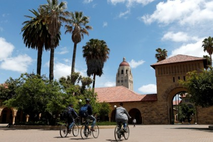 Cyclists traverse the main quad on Stanford University's campus in Stanford, California, US, on 9 May 2014. (Beck Diefenbach/Reuters)