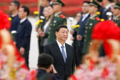 Chinese President Xi Jinping arrives for a ceremony at the Monument to the People's Heroes at Tiananmen Square to mark Martyrs' Day, in Beijing, China, 30 September 2021. (Carlos Garcia Rawlins/Reuters)