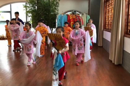Elementary school students in Wuhan decked out in their performance outfits.