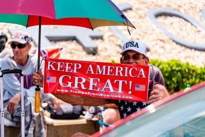 "A person holds a sign that reads ""Keep America Great!"" outside of the BOK Center ahead of a rally for US President Donald Trump in Tulsa, Oklahoma, US, on 17 June 2020. (Christopher Creese/Bloomberg)"