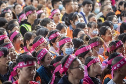 Employees attend a pep rally in the yard of a Cainiao warehouse, the logistics subsidiary of Alibaba Group Holding Ltd., ahead of the company's annual Singles' Day shopping extravaganza in Wuxi, Jiangsu province, China, on 9 November 2020. (Qilai Shen/Bloomberg)