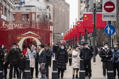 Pedestrians walk down Nanjing Road in Shanghai, China, on 12 February 2021. (Qilai Shen/Bloomberg)