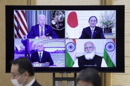 U.S. President Joe Biden (top left), Yoshihide Suga, Japan's prime minister (top right), Scott Morrison, Australia's prime minister (bottom left), and Narendra Modi, India's prime minister, on a monitor during the virtual Quadrilateral Security Dialogue (Quad) meeting at Suga's official residence in Tokyo, Japan, on 12 March 2021. (Kiyoshi Ota/Bloomberg)