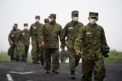 Japan's Ground Self-Defense Forces (JGSDF) soldiers wearing protective face masks arrive for a live fire exercise at JGSDF's training grounds in the East Fuji Maneuver Area in Gotemba, Japan, on 22 May 2021. A key part of US President Joe Bidens foreign policy has been turning to allies for support in addressing the security risks posed by the likes of China and North Korea, placing a greater emphasis on the Indo-Pacific region. (Akio Kon/Bloomberg)