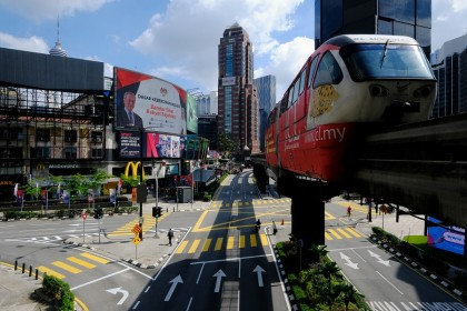 A rapidKL train travels along an elevated track above streets in Kuala Lumpur, Malaysia on 1 June 2021. (Samsul Said/Bloomberg)