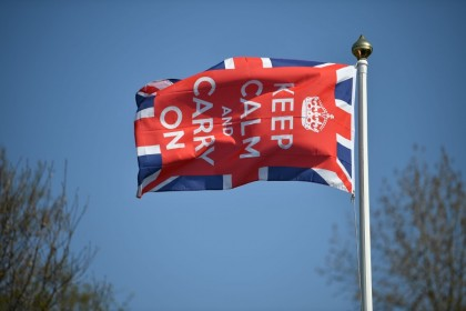 A Keep Calm and Carry On flag flies in the garden of a home in Bodiam, southern England, 9 April 2020. China-Britain ties have cooled in the past few months. (Ben Stansall/AFP)