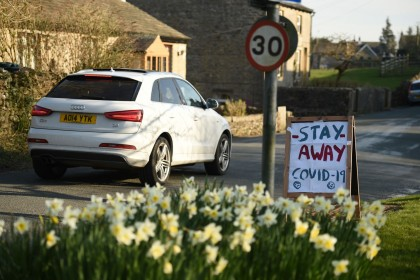 "A sign instructing tourists to ""Stay Away"" is seen beside the road in the village of Airton in northern England on 22 March 2020. (Oli Scarff/AFP)"