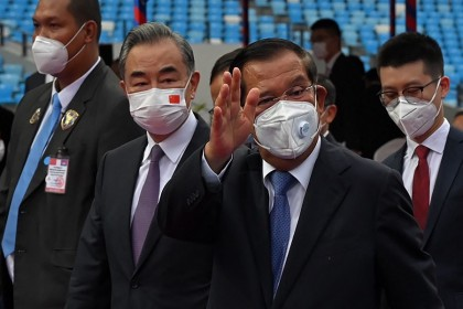 Cambodia's Prime Minister Hun Sen (second from right) gestures as Chinese Foreign Minister Wang Yi (centre, left) looks on as they attend a handover ceremony of the Morodok Techo National Stadium, funded by China's grant aid under its Belt and Road Initiative, in Phnom Penh, Cambodia, on 12 September 2021. (Tang Chhin Sothy/Pool/AFP)