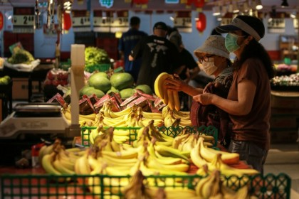 Customers buy bananas at a market in Shenyang, in China's northeastern Liaoning province on 10 August 2020. (STR/AFP)