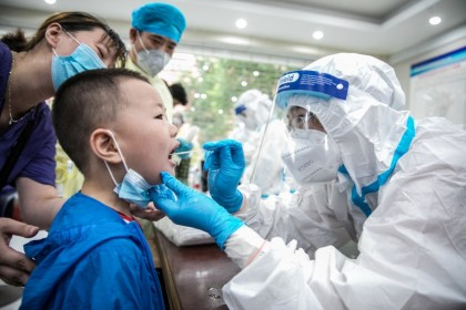 This photo taken on 8 August 2021 shows a child being given a nucleic acid test for the Covid-19 coronavirus in Nantong, in China's eastern Jiangsu province. (STR/AFP)
