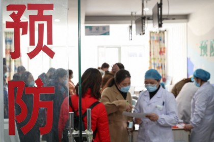 This photo taken on 21 March 2021 shows people waiting to receive the Covid-19 coronavirus vaccine at a hospital in Huai'an, Jiangsu province, China. (STR/AFP)