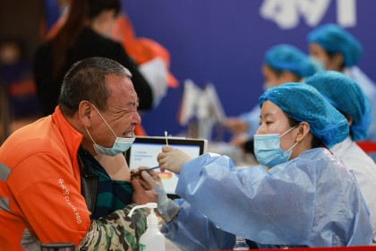 This photo taken on 23 May 2021 shows a sanitation worker receiving the China National Biotec Group (CNBG) Covid-19 vaccine in Shenyang, Liaoning province, China. (STR/AFP)