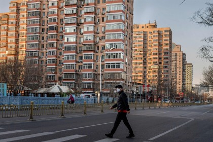 A man wearing a protective mask walks along an empty street in Beijing on 31 January 2020, following the Wuhan coronavirus outbreak. (Nicolas Asfouri/AFP)