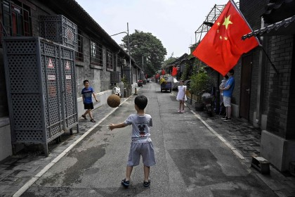 Children play with a basketball in an alley in Beijing, China on 26 June 2021. (Jade Gao/AFP)