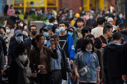 People walk along a pedestrian street in Shanghai on 28 October 2020. (Hector Retamal/AFP)