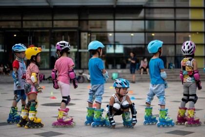 Children learn skating in Beijing on 11 August 2020. (Noel Celis/AFP)