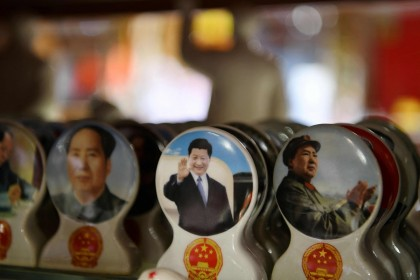 Souvenirs featuring Chinese President Xi Jinping (centre) and late communist leader Mao Zedong (right) are seen at a store in Beijing on 2 March 2021. (Greg Baker/AFP)