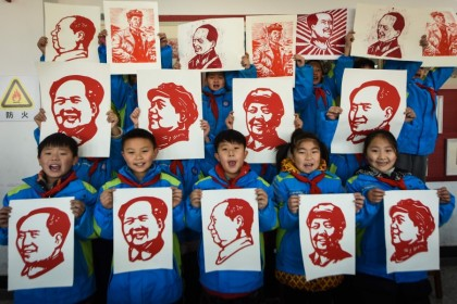 Students display their paper cutting portraits of the late former Chinese Communist Party leaderMaoZedongahead of his 127th birthday which falls on 26 December, in Lianyungang in eastern China's Jiangsu province on 23 December 2020. (STR/AFP)