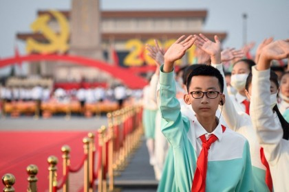 A student waves during a rehearsal before celebrations in Beijing, China, on 1 July 2021, to mark the 100th anniversary of the founding of the Communist Party of China. (Wang Zhao/AFP)
