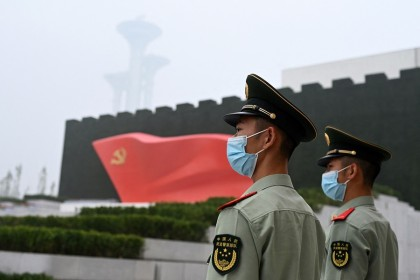 Paramilitary police stand outside the Museum of the Communist Party of China, near the Bird's Nest national stadium in Beijing, China on 25 June 2021. (Noel Celis/AFP)