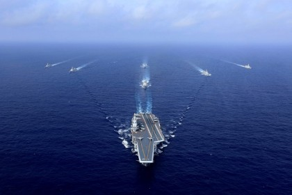 This file photo taken on 18 April 2018 shows China's aircraft carrier, the Liaoning (centre), sailing during a drill at sea. (STR/AFP)