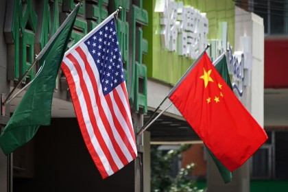 Tension between China and the US is intensifying. This file photo taken on May 14, 2019 shows the US (L) and Chinese flags (R) displayed outside a hotel in Beijing. (Greg Baker/AFP)