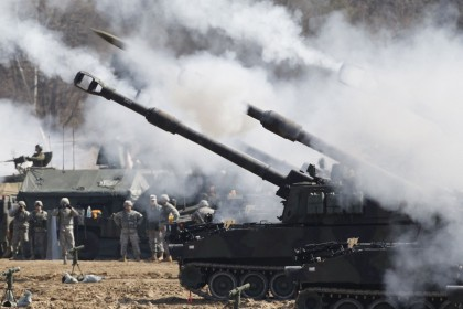 This file photo taken on 15 March 2012 shows US Army M109A6 Paladin self-propelled howitzers of the Second Infantry Division of the US Forces Korea attending a live firing drill at the US army's Rodriguez range in Pocheon, south of the demilitarised zone that divides the two Koreas. (Kim Hong-Ji /Pool/ AFP)