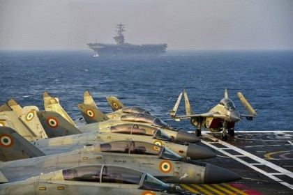 This handout file photo taken and released by the Indian Navy on 18 November 2020 shows Indian army fighter jets on the deck on an aircraft carrier during the second phase of the 2020 Malabar naval exercise in the Arabian sea involving India, Australia, Japan and the US (the Quad). (Indian Navy/AFP)