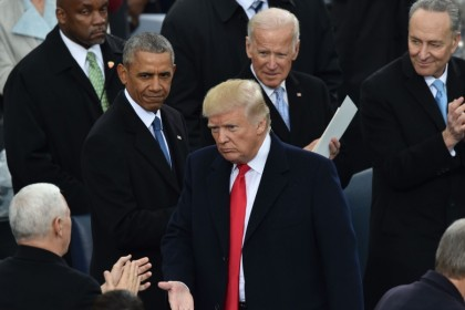 In this file photo US President Donald Trump (C) is applauded by former President Barack Obama (L) and former Vice President Joe Biden during Trump's inauguration ceremonies at the US Capitol in Washington, DC, on 20 January 2017. (Paul J. Richards/AFP)