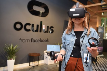 In this file photo taken on 23 October 2019, a Facebook employee tries out an Oculus device at the company's corporate headquarters campus in Menlo Park, California. (Josh Edelson/AFP)