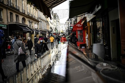 People walk along a commercial street in central Paris, France, on 23 December 2020. (Christophe Archambault/AFP)