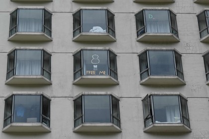 This picture shows messages posted on windows by quarantined guests at a hotel in Hong Kong on 26 September 2021. (Peter Parks/AFP)