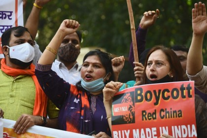 Demonstrators shout slogans as they take part in a protest march againstChinanear the Chinese Embassy in New Delhi on 20 October 2020. (Sajjad Hussain/AFP)