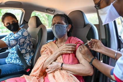 An elderly woman gets inoculated with a dose of theCovishieldvaccine against the Covid-19 coronavirus at a drive-in vaccination facility in Mumbai on 11 May 2021. (Punit Paranjpe/AFP)