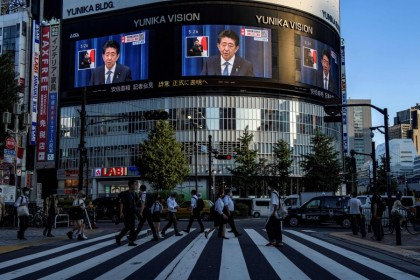 Japanese Prime Minister Shinzō Abe is seen on a large screen during a live press conference in Tokyo on 28 August 2020, as he announced that he will resign over health problems.