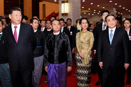 This handout picture released by Myanmar News Agency (MNA) shows Chinese President Xi Jinping (L), Myanmar President Win Myint (2nd L) and Myanmar State Counsellor Aung San Suu Kyi (2nd R), attending a ceremony marking Myanmar and China's 70th anniversary of diplomatic relations in Naypyidaw, January 2020. (Handout/AFP)