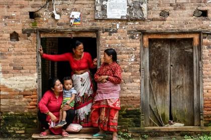 Residents wait to watch the processions of the 'Ropain' or rice plantation festival and the 'Gai Jatra' Hindu festival at Khokana village on the outskirts of Kathmandu on 5 August 2020. (Prakash Mathema/AFP)