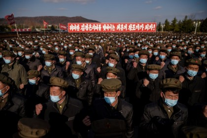 In a photo taken on 20 November 2020, divisions of returning elite party members attend a meeting to pledge loyalty before the portraits of late North Korean leaders Kim Il Sung and Kim Jong Il, upon their arrival at Kumsusan palace in Pyongyang, following their deployment to rural provinces to aid in recovery efforts amid damage caused by a September typhoon. (Kim Won Jin/AFP)