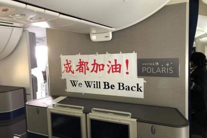 "The last flight we took from Chengdu to San Francisco. The banner reads: ""Chengdu, you can do it! We will be back""."