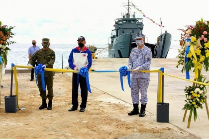 This handout photo received on 9 June 2020 from the Department National Defense Philippines (DND), shows Defense secretary Delfin Lorenzana (centre) along with military officials cutting a ribbon during the inauguration ceremony of the newly constructed beach-ramp at Philippine-held Pag-asa Island also known as Thitu Island in the Spratly archipelagos. (Handout/Department National Defense Philippines (DND)/AFP)