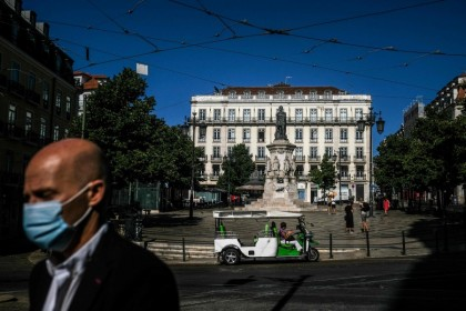 A tuktuk is parked at Camoes square in Lisbon on 14 July 2021. (Patricia de Melo Moreira/AFP)