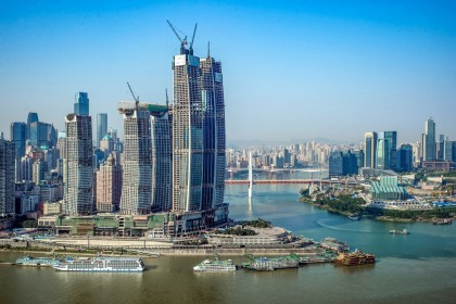 Inspired by the region's thousand years of waterway transportation culture, Raffles City Chongqing's award-winning design takes the form of powerful sail surging forward on the historic Chaotianmen site where Yangtze and Jialing rivers meet. The photo shows a side profile of Raffles City Chongqing. (CapitaLand)