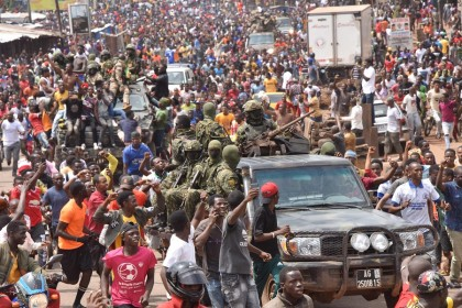 People celebrate in the streets with members of Guinea's armed forces after the arrest of Guinea's president, Alpha Conde, in a coup d'etat in Conakry, Guinea, 5 September 2021. (Cellou Binani/AFP)